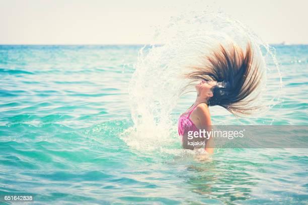 Beautiful Young Girl Enjoying on The Beach