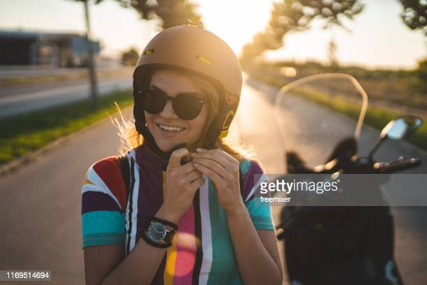 beautiful young girl getting ready for the ride - crash helmet stock pictures, royalty-free photos & images