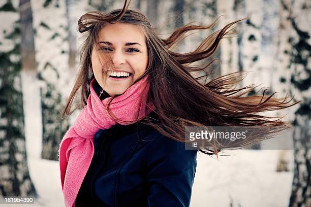Beautiful young girl happy. Her hair fluttering