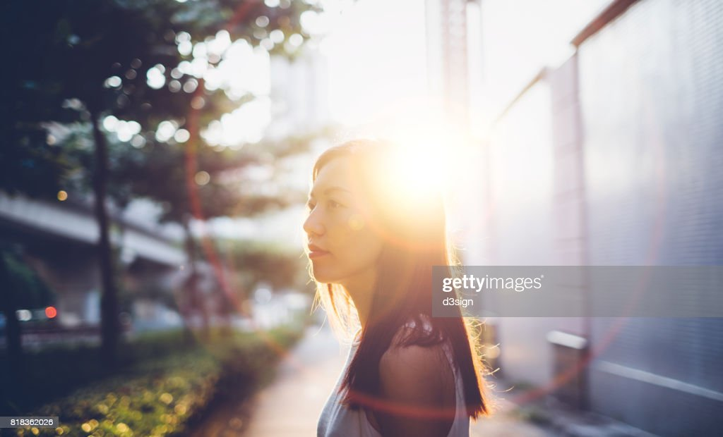 Beautiful young girl having a refreshing morning in sunrise : Stock Photo