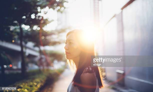 Beautiful young girl having a refreshing morning in sunrise