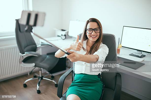Beautiful young girl in office