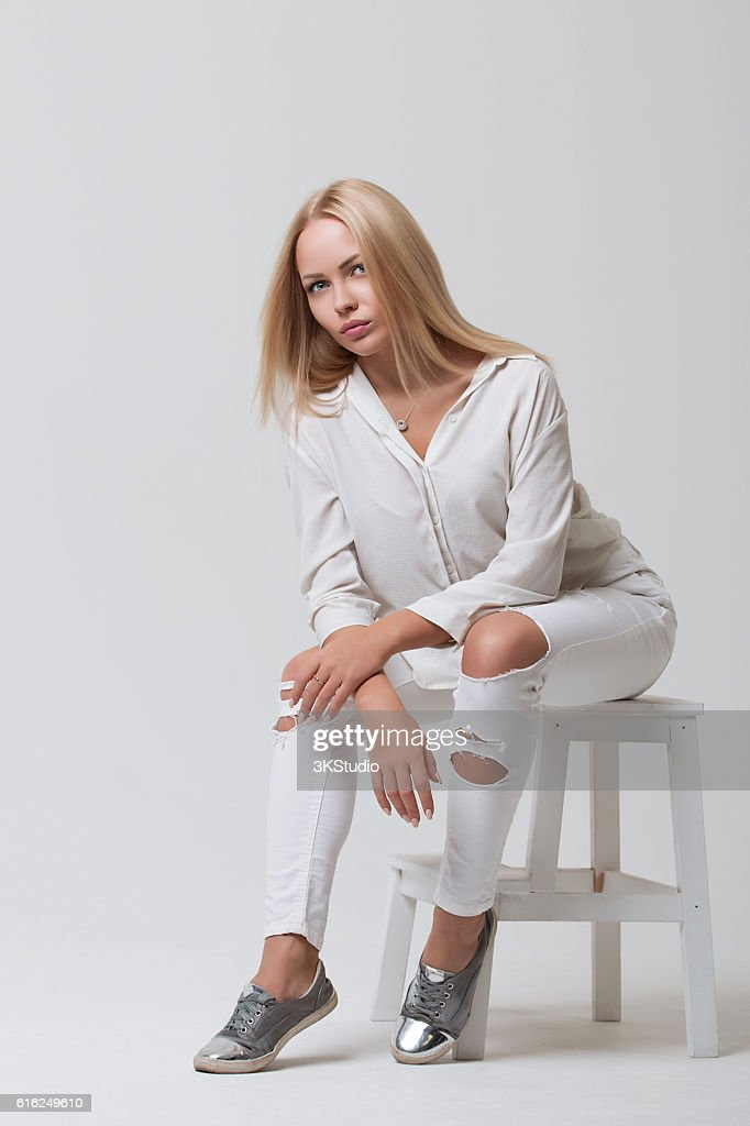 Beautiful young girl in white : Stock Photo