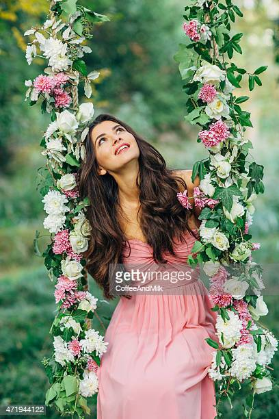 beautiful young girl on a swing - pink dress stock photos and pictures