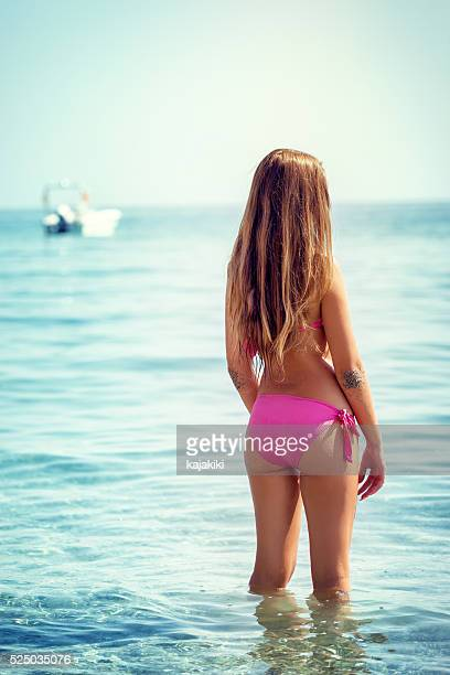 beautiful young girl on the beach - little girls bare bum stock pictures, royalty-free photos & images