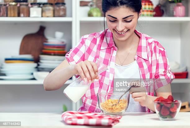 Beautiful Young Girl Preparing Healthy Breakfast