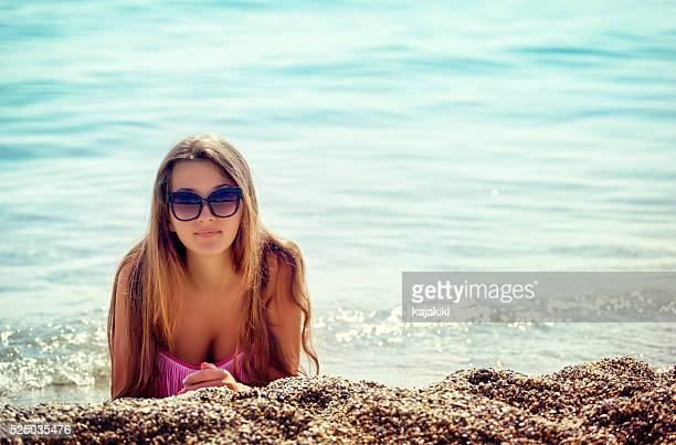 beautiful young girl relaxing on the beach - hot body girls stock photos and pictures