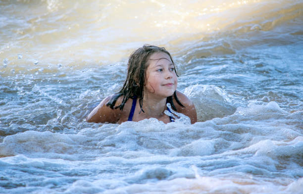Beautiful Young Girl Rises Out Of Active Water As She Plays In Lake Michigan