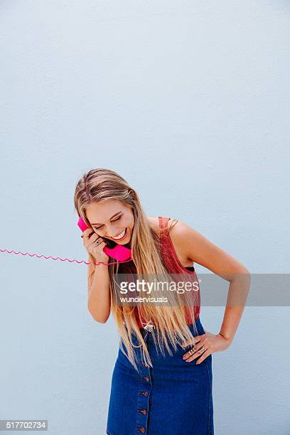 Beautiful young girl smiling during phone call
