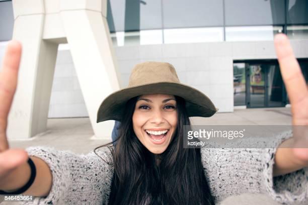 Beautiful young girl taking smiling selfie
