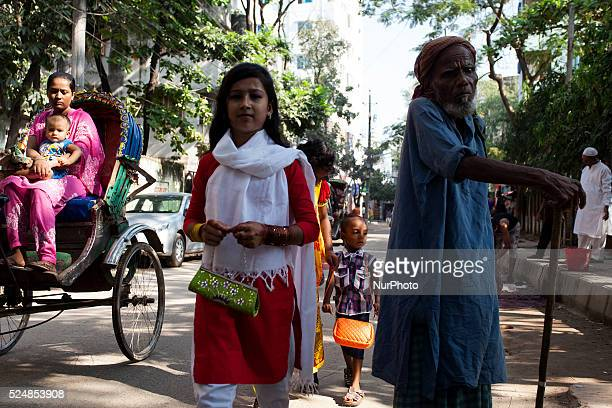 A beautiful young girl was going to a friend's place while a poor man was standing on the road awaiting some help from others in Dhaka Bangladesh...
