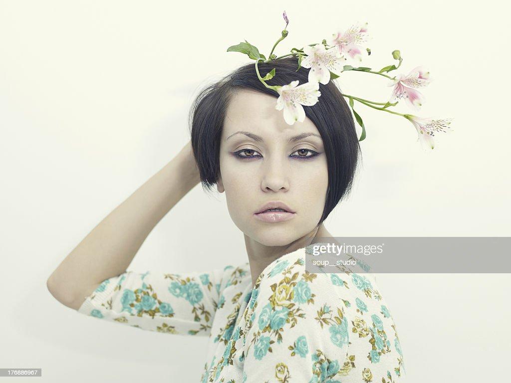 Beautiful young girl with flowers stock photo getty images beautiful young girl with flowers stock photo izmirmasajfo