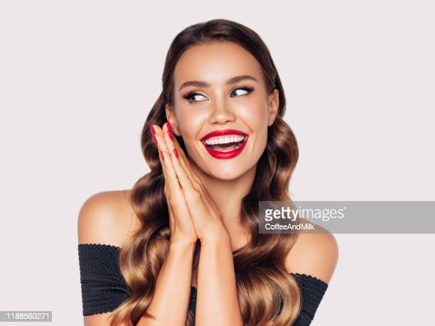 beautiful young girl with nice sincere smile - red lipstick stock pictures, royalty-free photos & images