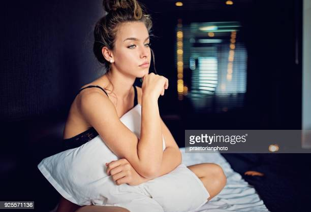 beautiful young girl with relationship difficulties standing sad in the bed - victim stock pictures, royalty-free photos & images