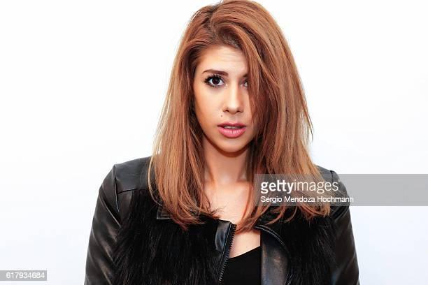 Beautiful young Hispanic woman on a white background