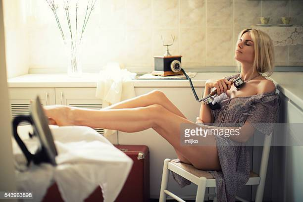 Beautiful young housewife relaxing