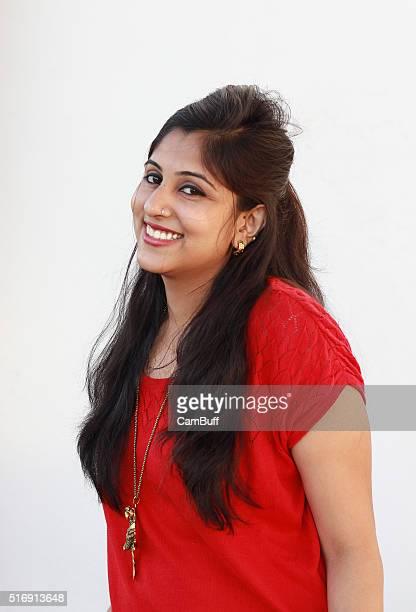 Beautiful young indian woman smiling at camera