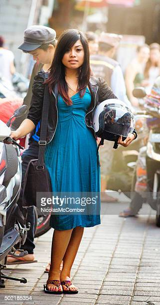 Beautiful young Indonesian woman full length portrait with helmet