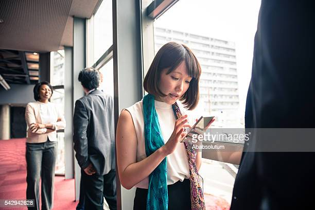 Beautiful Young Japanese Businesswoman with Smart Phone, Kyoto, Japan
