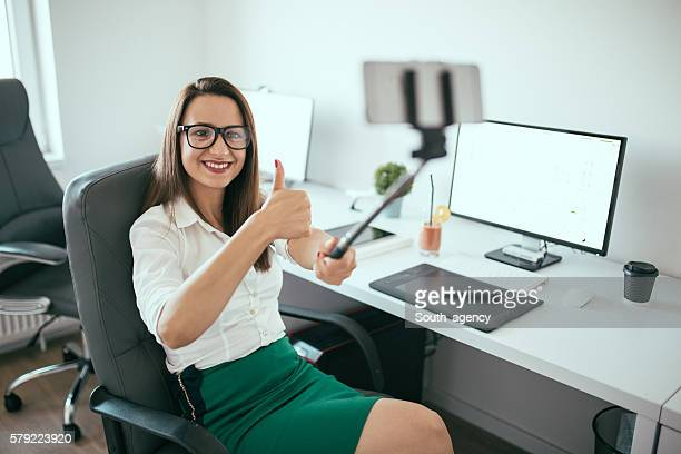 Beautiful young lady in office