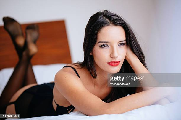 beautiful young lady in sexy underwear on bed - woman flat chest stock photos and pictures