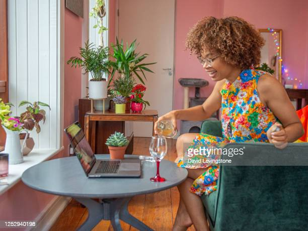 beautiful young lady preparing for a video call party on line celebrating gay pride from home. - multi coloured stock pictures, royalty-free photos & images
