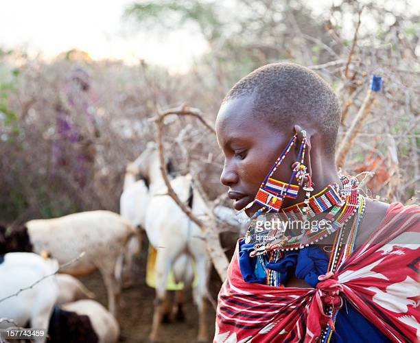 Beautiful young maasai woman with goats.