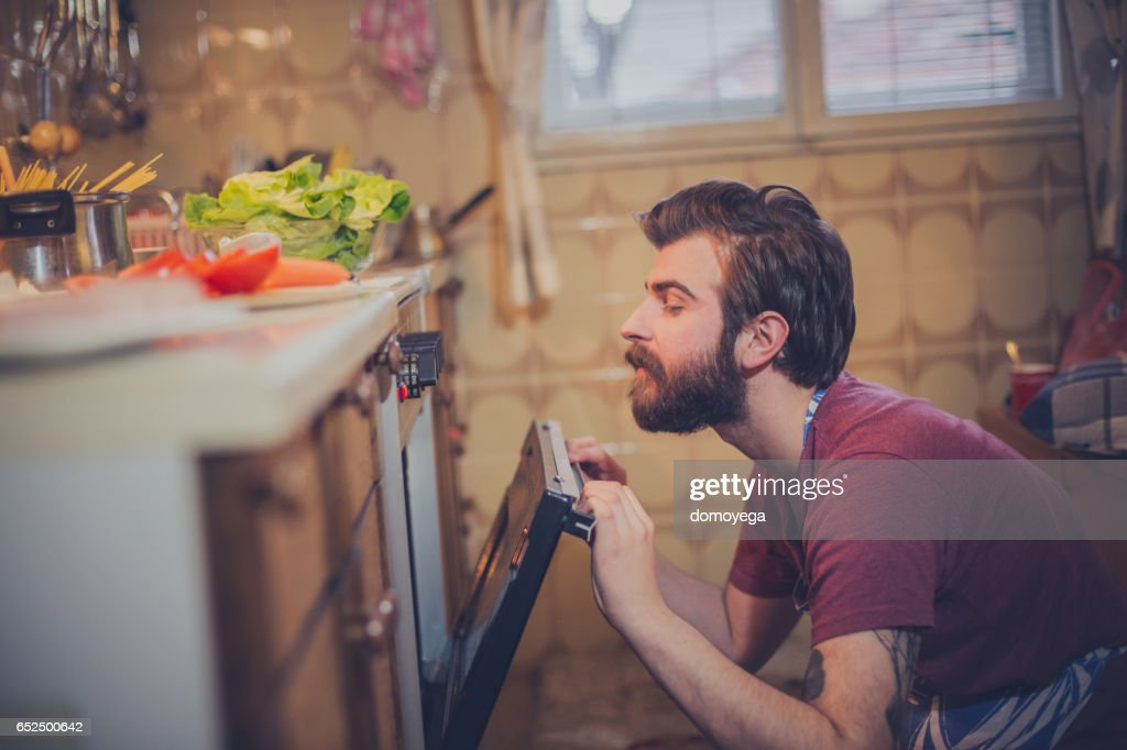 Beautiful young man preparing healthy meal : Stock Photo