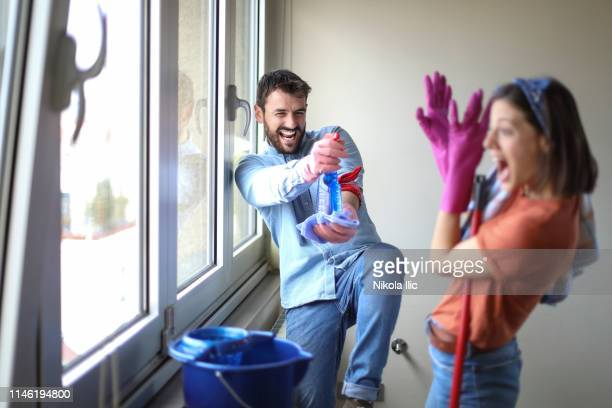 beautiful young married couple cleaning apartment - kids with cleaning rubber gloves stock pictures, royalty-free photos & images