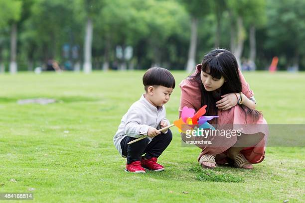 beautiful young mother and child in the park