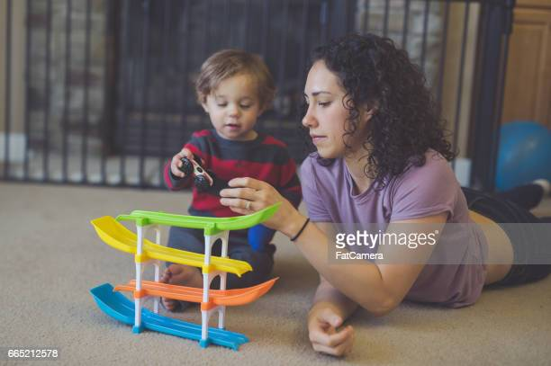 beautiful young mother playing with her young child - waterloo iowa stock pictures, royalty-free photos & images