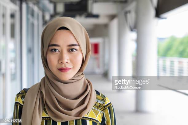 beautiful young muslim asian female urban portrait - south east asian ethnicity stock pictures, royalty-free photos & images