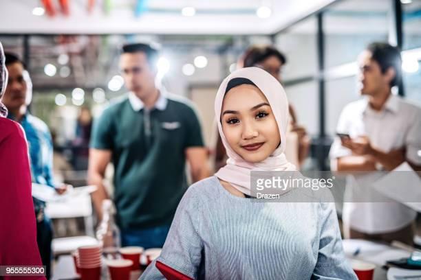 Beautiful young Muslim team leader