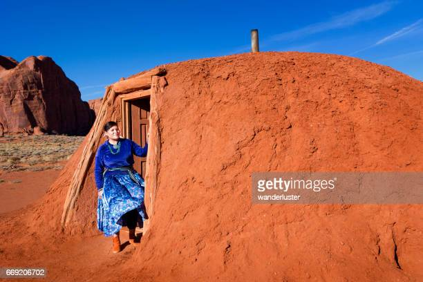 Beautiful young Navajo woman outside her hogan