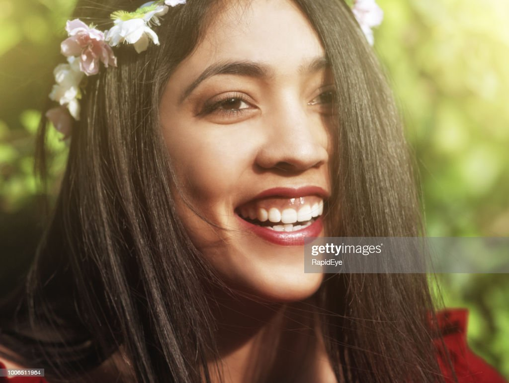 Beautiful young oliveskinned woman with flower garland smiles stock beautiful young olive skinned woman with flower garland smiles stock photo izmirmasajfo