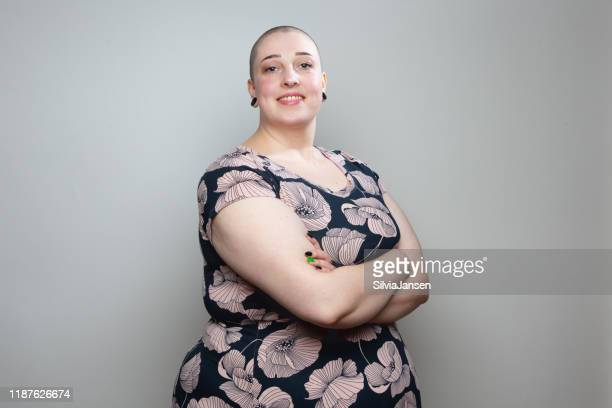 beautiful young overweight woman with shaved head - chubby stock pictures, royalty-free photos & images