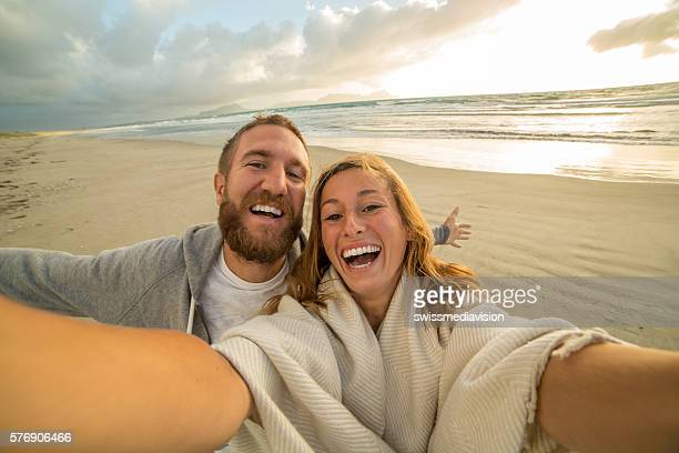 Beautiful young people take selfie portrait on the beach