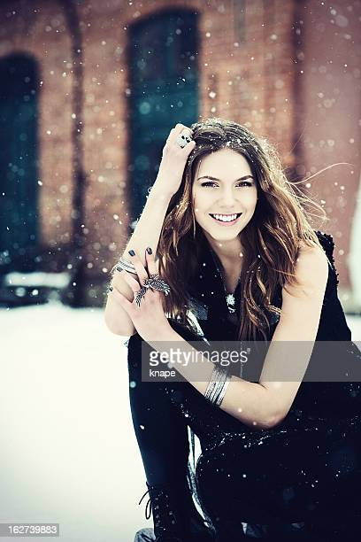 Beautiful young rock chic woman out in snow