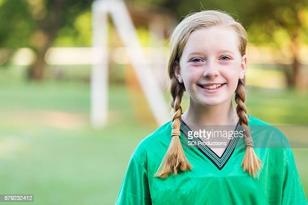 Beautiful young teenage girl soccer player