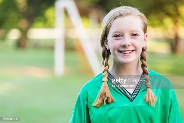 Beautiful young teenage girl soccer player