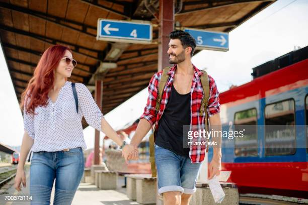 Beautiful young toursts in love at train station
