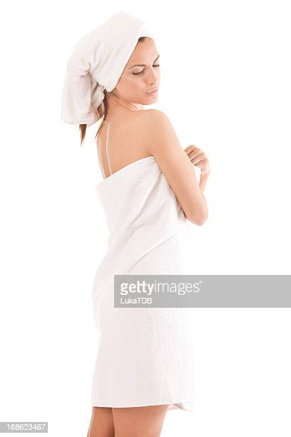 Beautiful young woman after shower isolated on white background