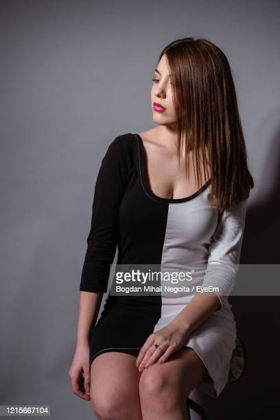 beautiful young woman against white background - bogdan negoita stock pictures, royalty-free photos & images