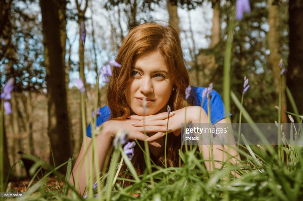 Beautiful young woman amongst the bluebells : Stock Photo