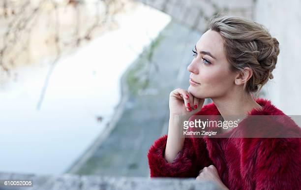 beautiful young woman at riverbank