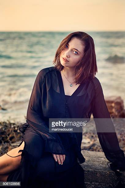 """beautiful young woman at the beach, sunset, enjoying nature. - """"martine doucet"""" or martinedoucet stockfoto's en -beelden"""