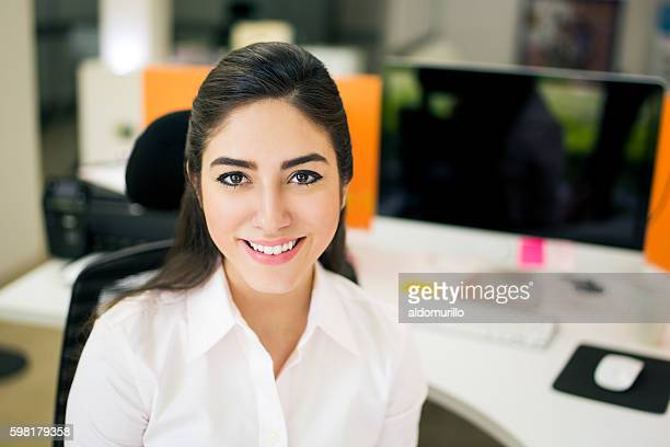 beautiful young woman at workplace - administrative professionals stock pictures, royalty-free photos & images