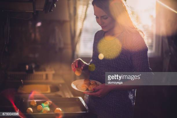Beautiful young woman baking pastry in the kitchen