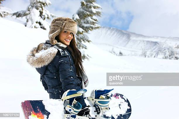 Beautiful Young Woman Carrying Snowboard on Snowy Mountain, Copy Space