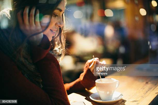 Beautiful young woman enjoying a coffee.